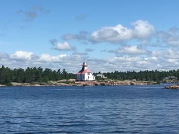 Old lighthouse at entrance to Snug HRBOR