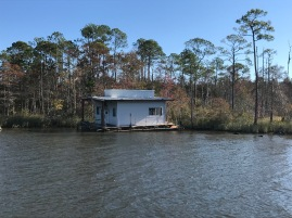 Scenic houseboat on some sweet waterfront property