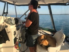 Jan and Lucky driving the boat